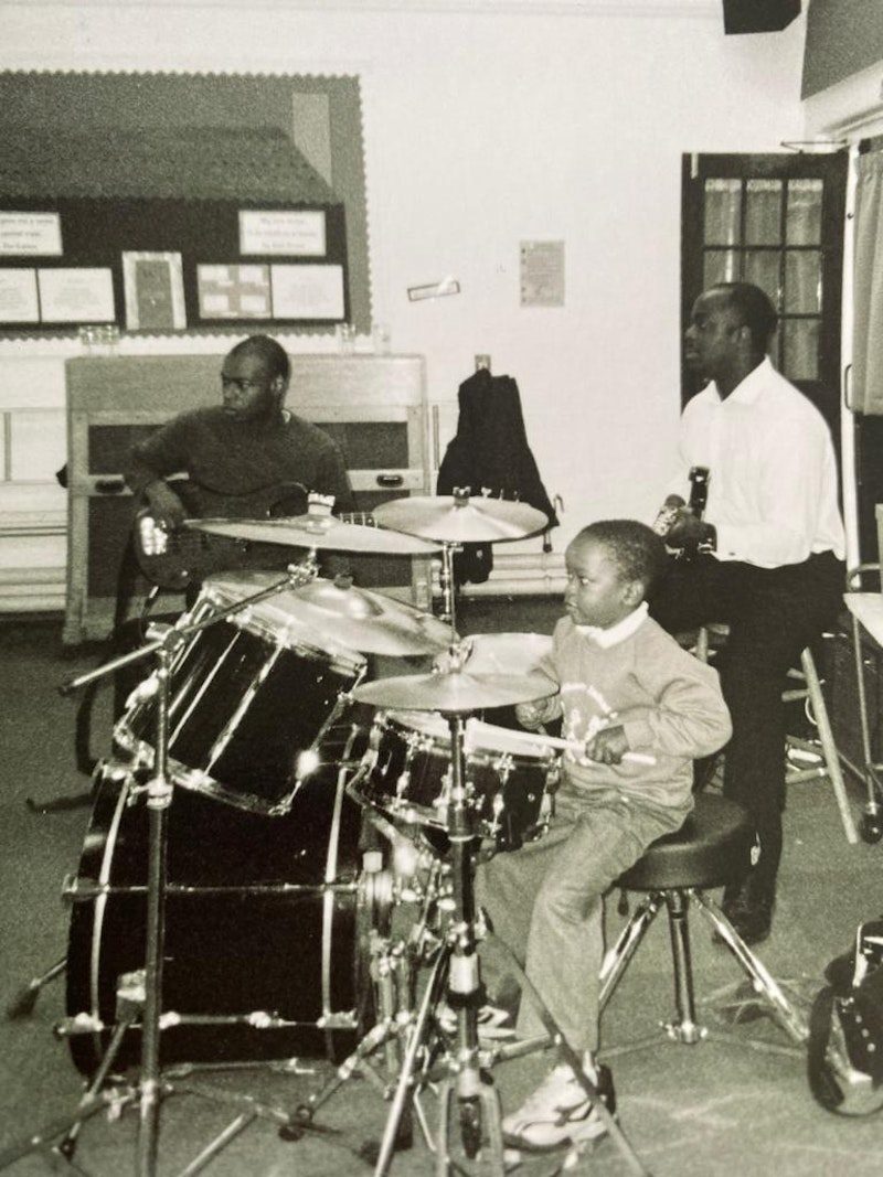 Morgan with his godfather on bass (left) and his dad playing guitar (right)